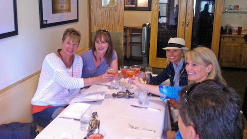 Group sitting at a dining table on the Walking Gourmet Food Tour in Vail