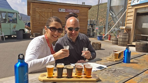 Couple enjoying samples of beer in Vail