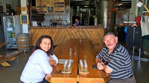 Couple enjoying beer sampling at the Vail Brewing Company in Vail