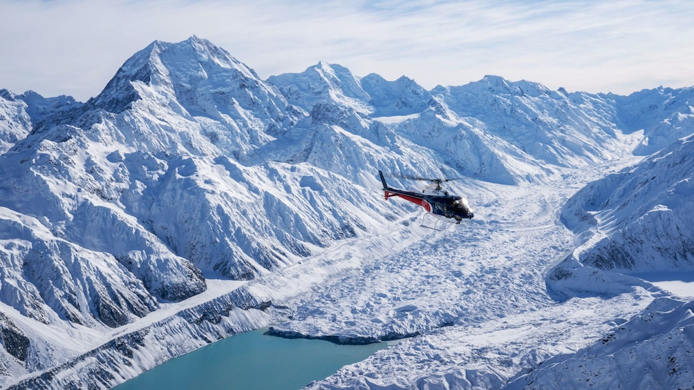 Show item 2 of 5. Helicopter flying over glacier and Mount Cook in New Zealand