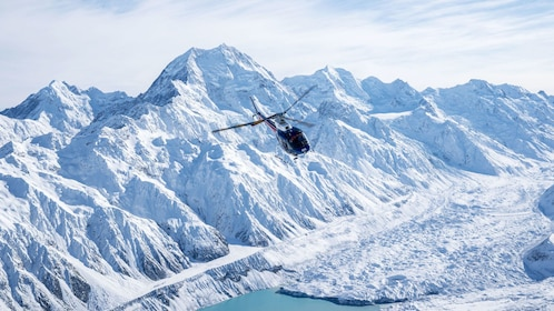 Helicopter flying over glacier and Mount Cook in Queenstown
