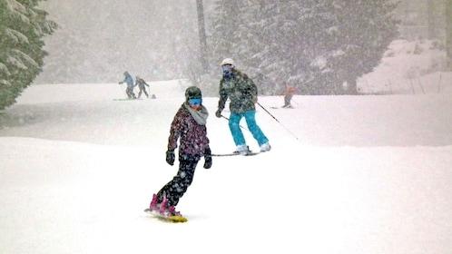 snowboarding through heavy snow in Whistler