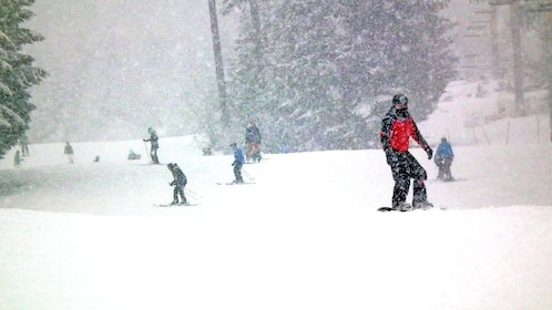 snowboarding during heavy snowfall in Whistler