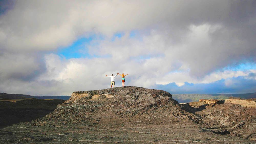 Two people atop a volcano.
