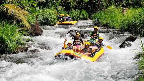 Group enjoying the White Water Rafting at Telaga Waja River in Indonesia