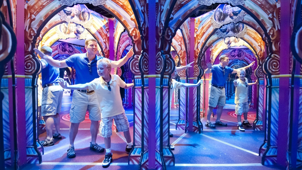 Show item 3 of 4. Father and son having fun at the Hollywood Wax Museum Entertainment Center in Myrtle Beach, South Carolina