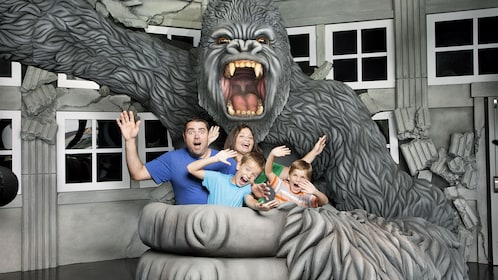 Family taking a photo with a fake gorilla at the Hollywood Wax Museum Entertainment Center in Myrtle Beach, South Carolina