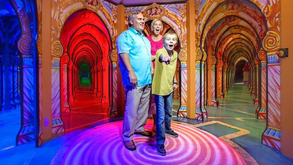 Family walking through a wax museum