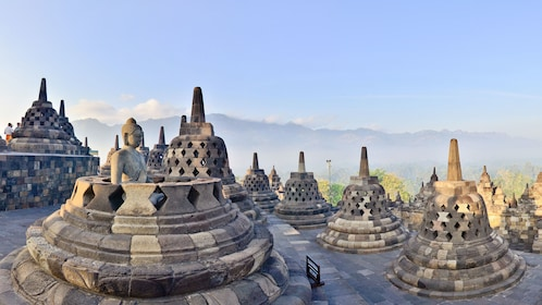 Stupas with mountains in the distance in Borobudur