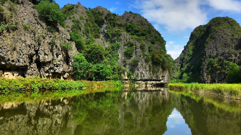 Show item 3 of 5. Serene river view of Tam Coc in Vietnam