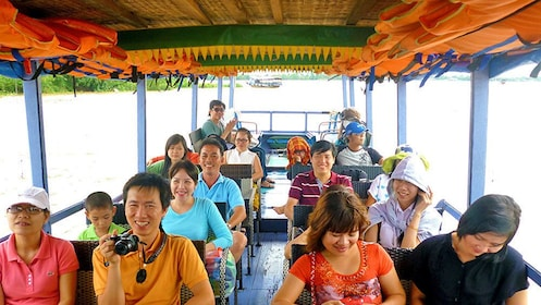 People having fan on tour boat in Ho Chi Minh City