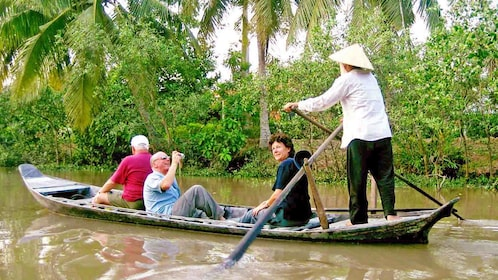 small group on a small wooden raft in Vietnam