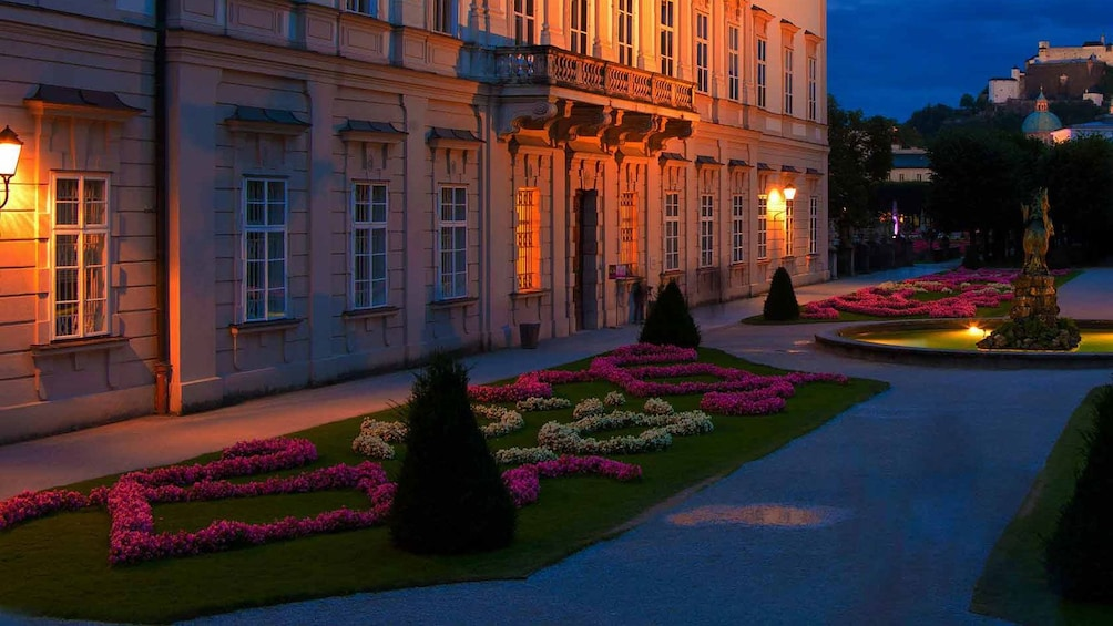 Show item 3 of 8. walking through the Mirabell garden during the evening in Austria