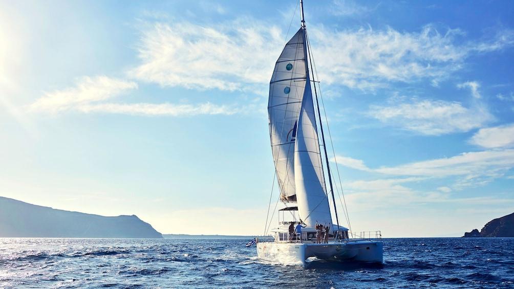 Show item 1 of 8. Catamaran sailing in Santorini