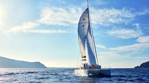 Catamaran sailing in Santorini