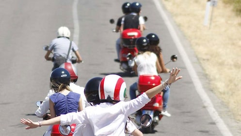Riding Vespas on the road in Italy