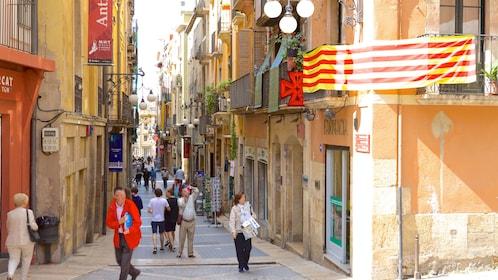 People walking down a narrow street in Sitges