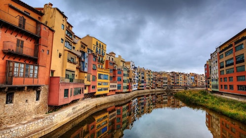 Canal with colorful buildings on either side in Costa Brava