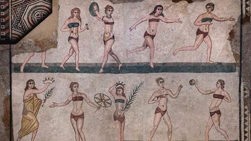 Close up of ancient artwork depicting several women.