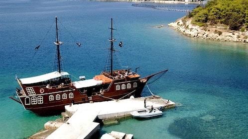 A Pirate ship anchored on a dock off the Greek coast.