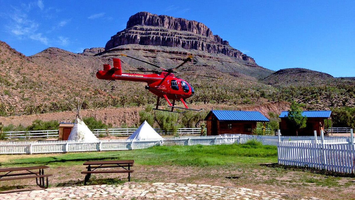 helicopter hovering near the ranch establishment at the Grand Canyon