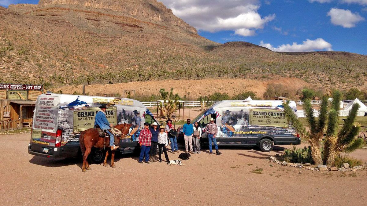rancher and visitors outside of van transportation at the Grand Canyon