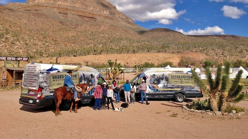 ranchers and visitors outside of van transportations at the Grand Canyon