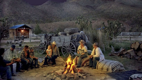 ranch visitors gathering around a campfire during the evening at the Grand Canyon