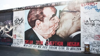 Show item 5 of 5. political artwork plastered on the Berlin Wall