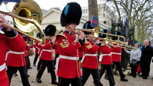 royal guards marching with brass instruments in London