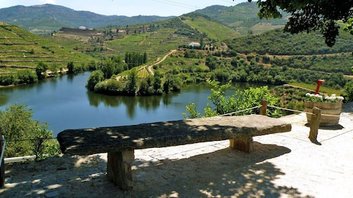 a stone bench overlooking the hills in Porto