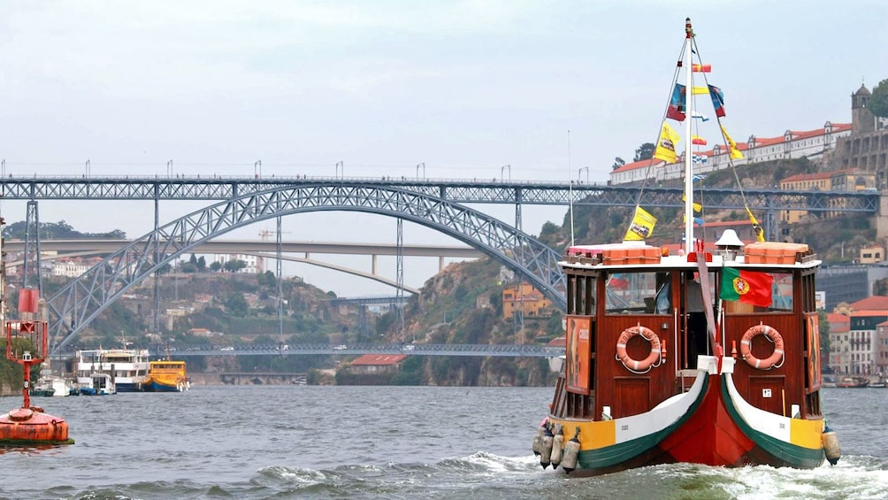 Show item 4 of 5. boat with colorful flags in Porto