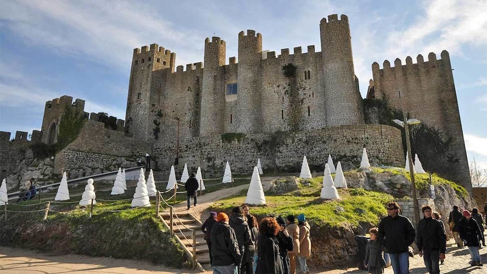 Show item 1 of 6. Tourists at the Obidos Castle in Lisbon