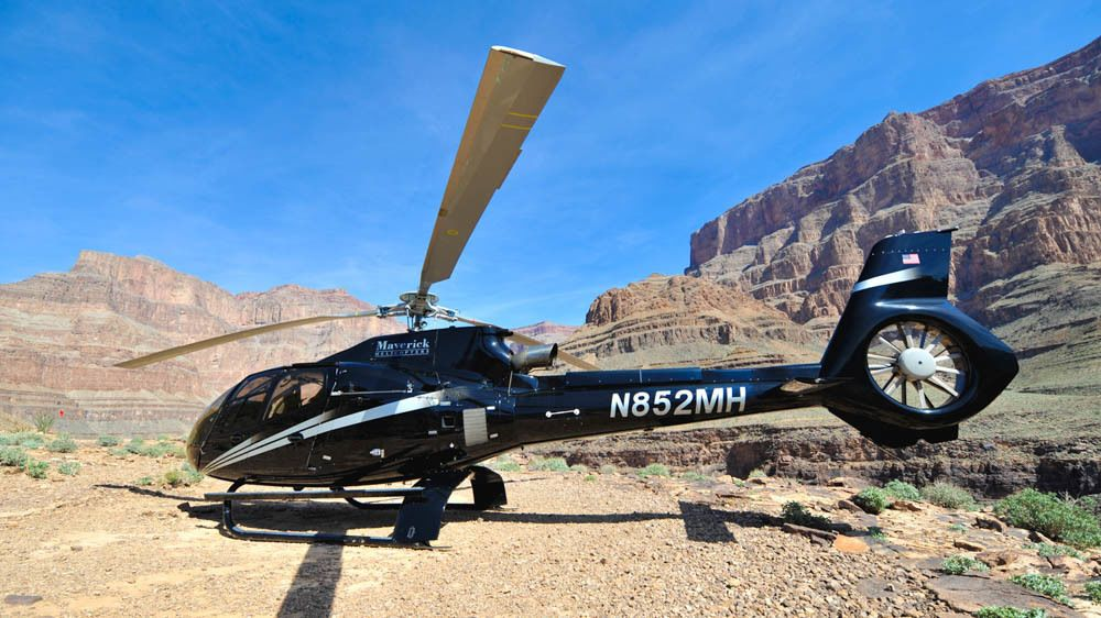 Grounded helicopter near canyons.