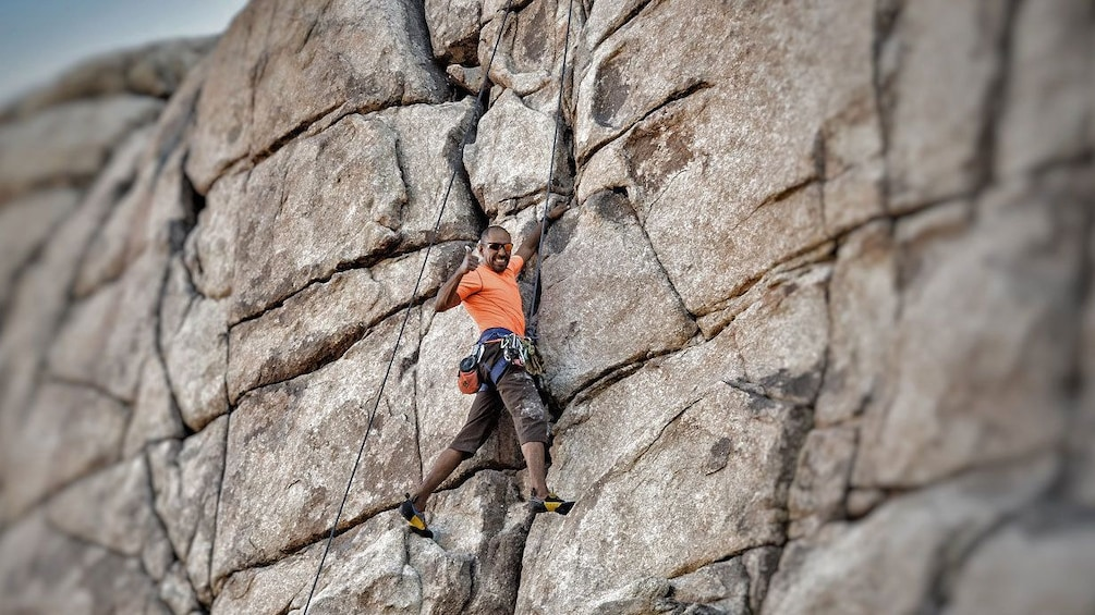 Show item 2 of 5. Rock climber on rock face in Ontario