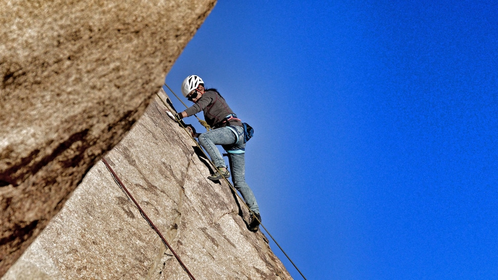 Show item 4 of 5. Rock climber on rock face in Ontario