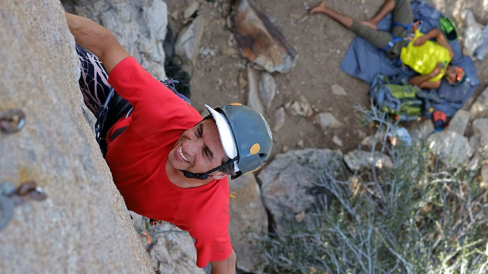 Show item 4 of 5. Rock climber in red shirt in Palm Springs