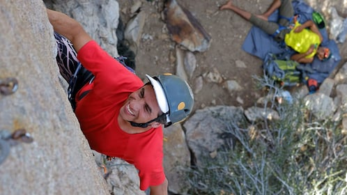 Rock climber in red shirt in Palm Springs