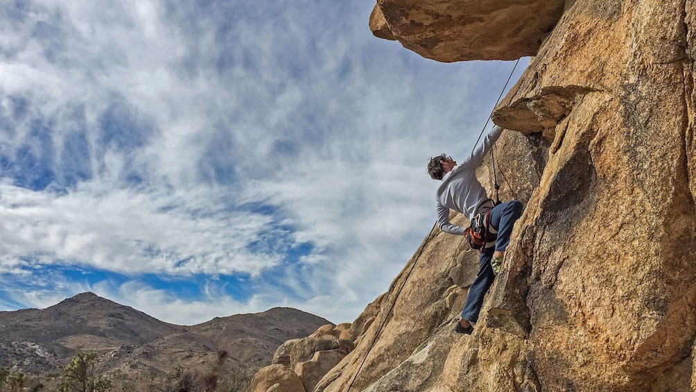 Show item 1 of 5. Rock climber climbing  in Palm Springs