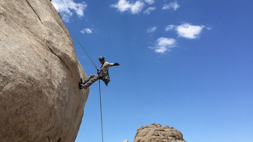 Rock climber repelling down rock face in Ontario