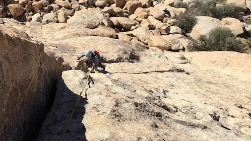 Man climbing rock in Ontario, California