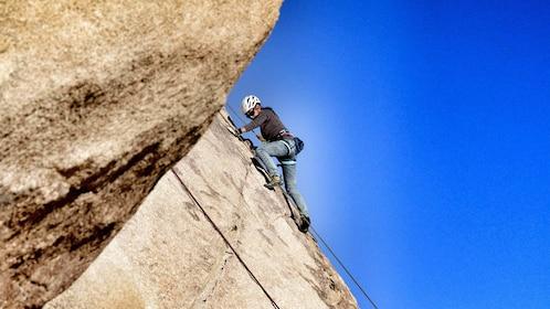 Woman rock climbing on a sunny day in Ontario, California