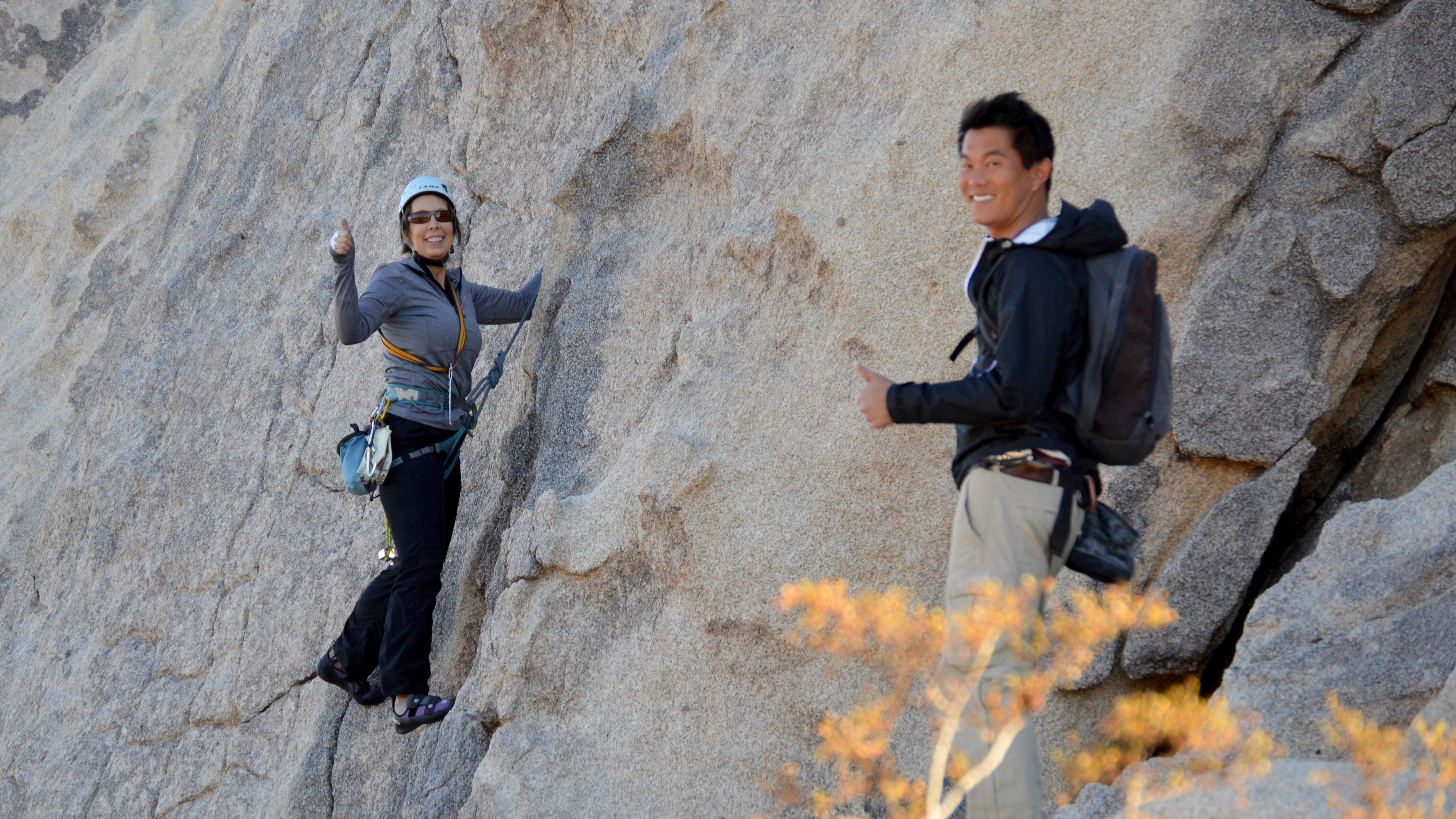 Rock climbing couple giving thumbs up in Ontario, California
