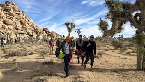 Rock climbing group walking on a path in Ontario, California