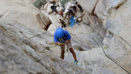 Climber on rock face in Ontario, California