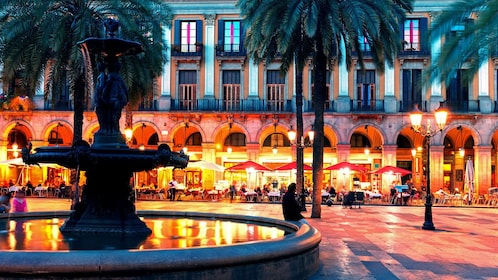evening outdoor dining near a water fountain in Barcelona