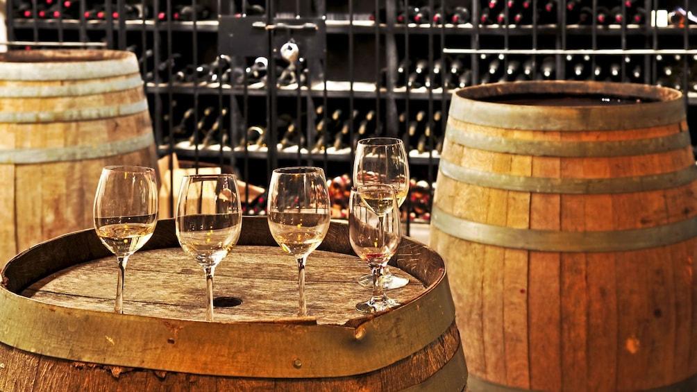 wine glasses on top of barrels inside the cellar in Barcelona