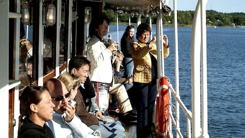 Tourists take pictures of the scenery on a Archipelago cruise