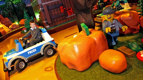 boy driving life size LEGO car in Manchester