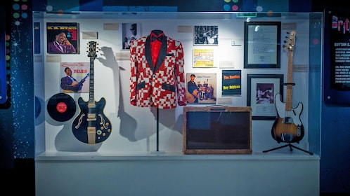 Beatles artifacts behind a glass case in Liverpool